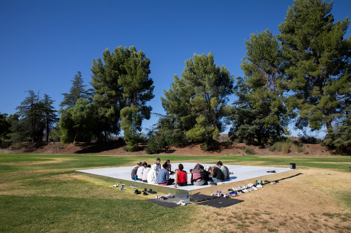 Outdoor floor with students and Emmanuelle Huynh