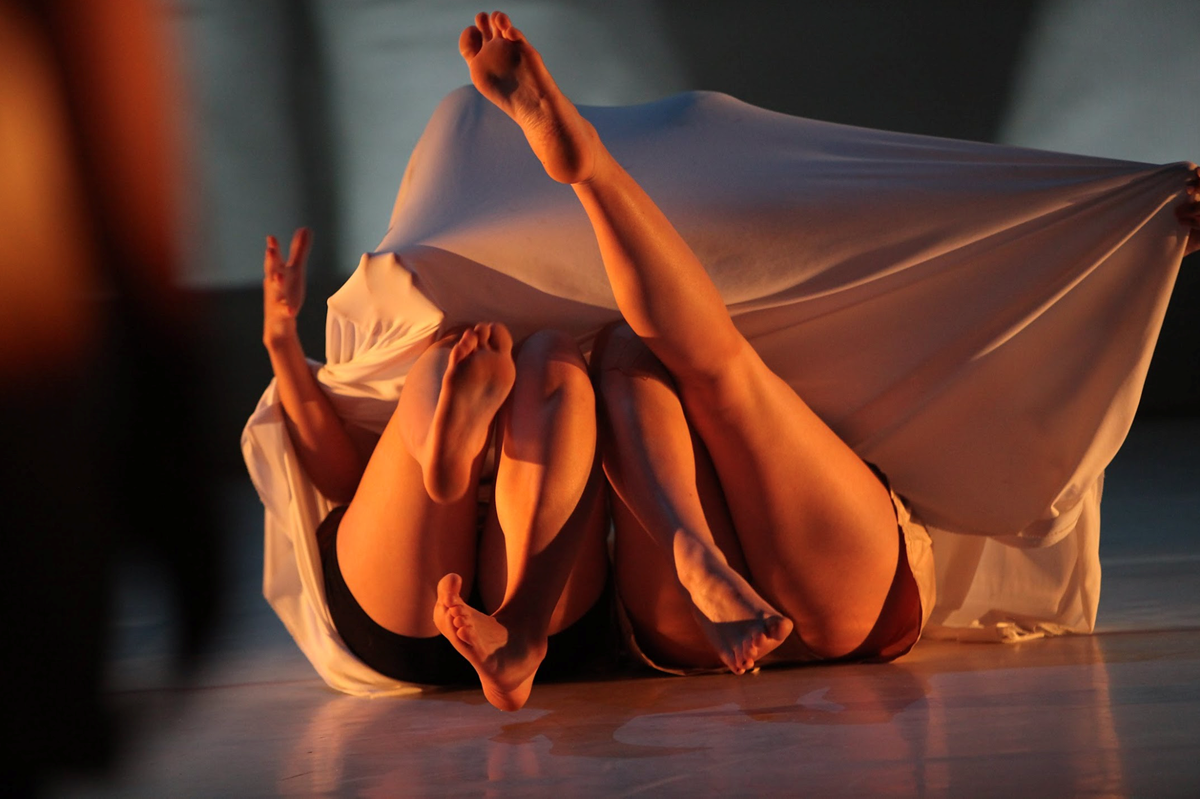 Two dancers legs under fabric
